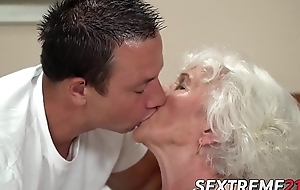 Blunt hair grandma teases with big bosom forwards banging
