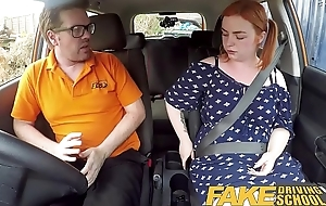 Fake Driving School Voluptuous redhead fucks in wheels